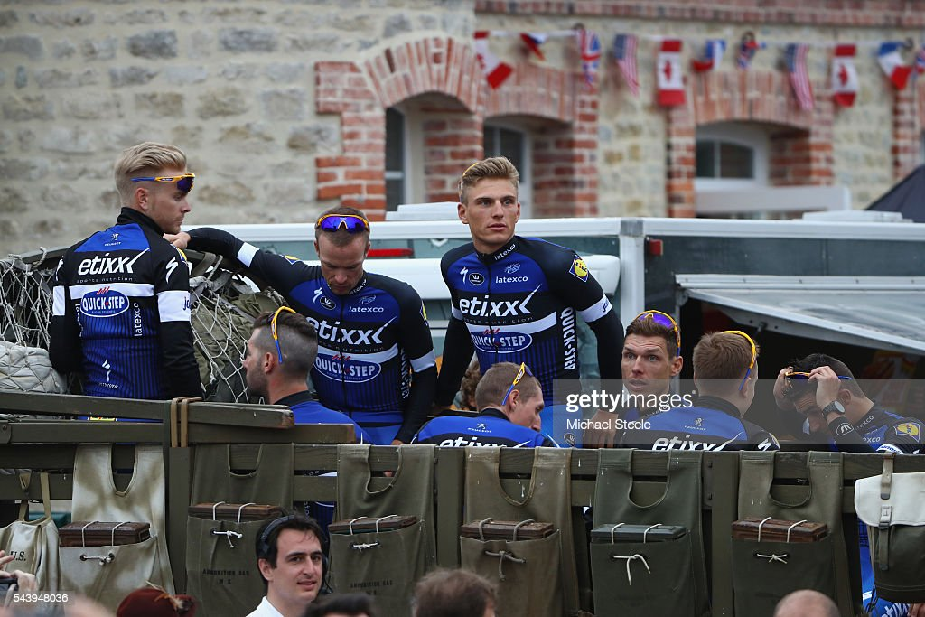 Marcel Kittel (C) of Germany and leader of Etixx Quickstep arrives aboard a first world war military vehicle during the team presentations on June 30, 2016 in Sainte-Mere-Eglise, France.