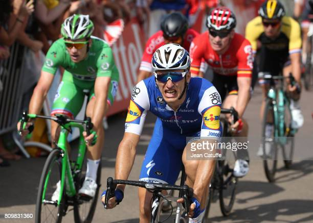 Marcel Kittel of Germany and Quick Step Floors celebrates winning in front of Arnaud Demare of France and FDJ and Andre Greipel of Germany and Lotto...