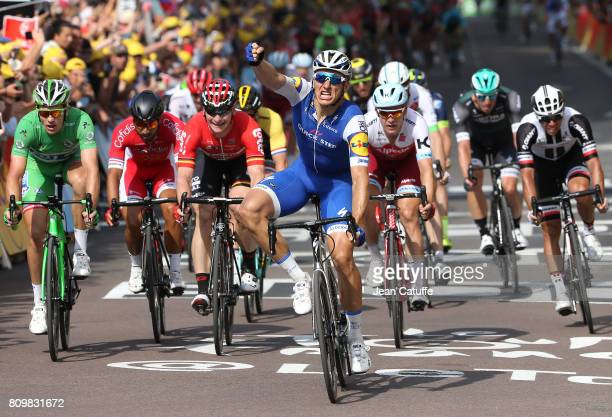 Marcel Kittel of Germany and Quick Step Floors celebrates winning in front of Arnaud Demare of France and FDJ Andre Greipel of Germany and Lotto...
