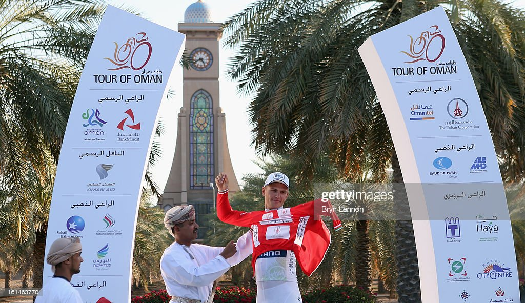 Marcel Kittel of Germany and Team Argos-Shimano pulls on the race leaders red jersey after winning stage one of the 2013 Tour of Oman from Al Musannah to Sultan Qaboos University on February 11, 2013 iatSultan Qaboos University, Oman.