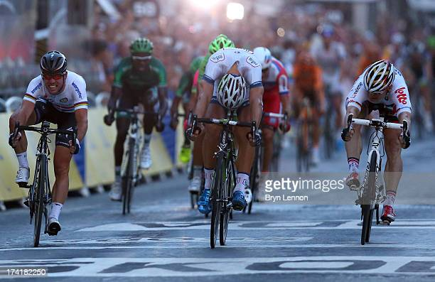 Marcel Kittel of Germany and Team ArgosShimano wins the sprint during the twenty first and final stage of the 2013 Tour de France a processional...
