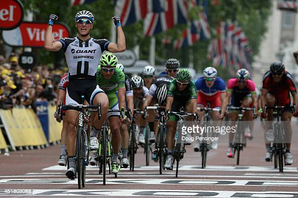 Marcel Kittel of Germany and Team GiantShimano celebrates as he wins stage three of the 2014 Le Tour de France from Cambridge to London on July 7...