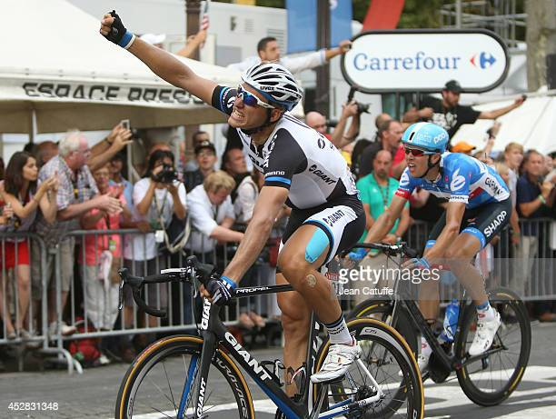Marcel Kittel of Germany and Team Giant-Shimano celebrates winning the twenty one and last stage of the 2014 Tour de France, a 134 km individual time...