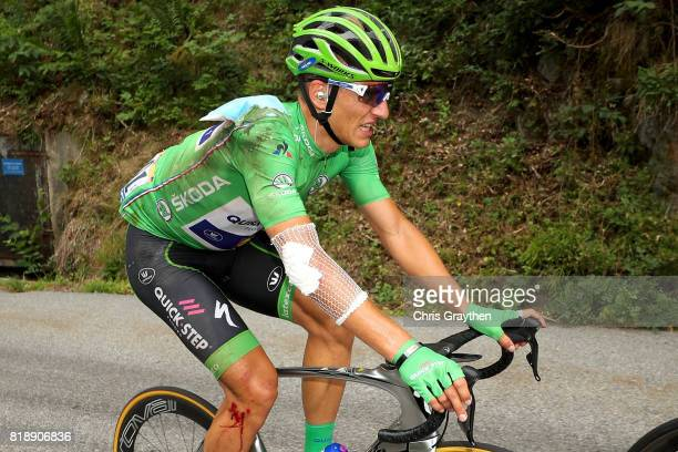 Marcel Kittel of Germany riding for QuickStep Floors in the green points jersey rides at the back of the peloton after a crash during stage 17 of the...