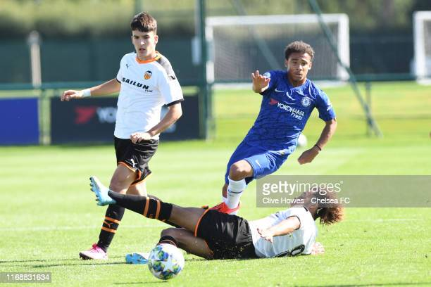 Marcel Lewis of Chelsea is tackled by Koba Koindredi of Valencia during the Chelsea FC U19 v Valencia U19 UEFA Youth League Group H match at Chelsea...