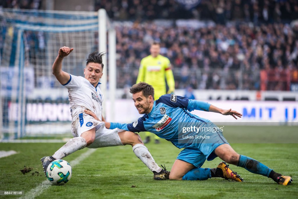 Marcel Mehlem (L) of Karlsruhe and Maximilian Welzmueller (R) of Aalen fight for the ball during the 3. Liga match between Karlsruher SC and VfR Aalen at Wildparkstadion on December 2, 2017 in Karlsruhe, Germany.