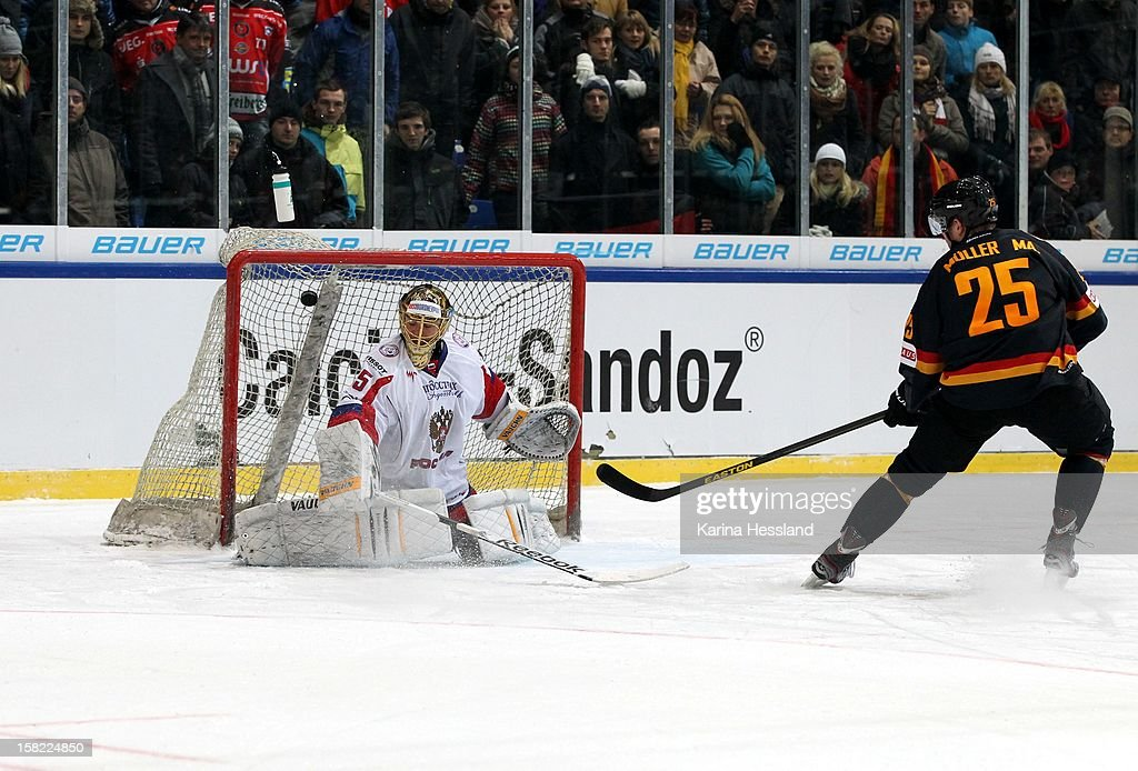 Marcel Mueller of Germany challenges goalkeeper Sergei Borisov of Russia on a penalty goal during the Top Teams Sochi match between Germany and Russia at Kuechwaldhalle on December 11, 2012 in Chemnitz, Germany.