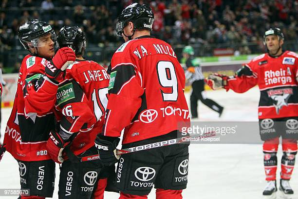 Marcel Mueller of Koelner Haie celebrates the first goal with team mates Moritz Mueller and Jason Jaspers during the DEL match between Koelner Haie...