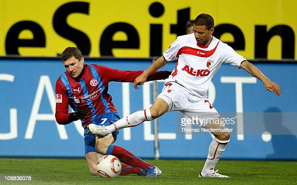 Marcel Ndjen of Augsburg fights for the ball with Oliver Fink of Duesseldorf during the second Bundesliga match between FC Augsburg and Fortuna...