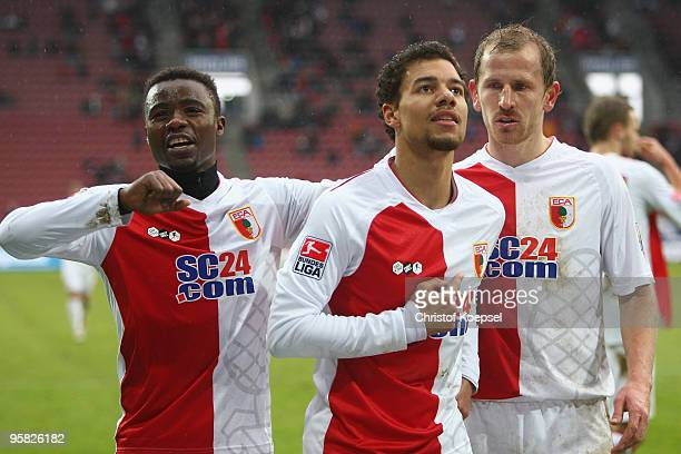 Marcel Ndjeng of Augsburg celebrates the third goal with Andrew Sinkala and Sándor Torghelle during the Second Bundesliga match between FC Augsburg...