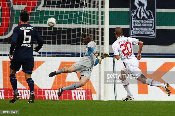 Marcel Ndjeng of Augsburg scores his team's third goal against Christoph Janker and goalkeeper Thomas Kraft of Berlin during the Bundesliga match...