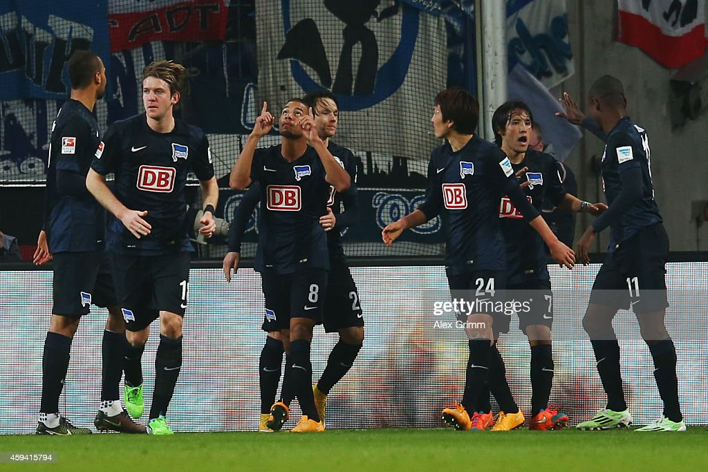 Marcel Ndjeng #8 of Berlin celebrates his team's second goal with team mates during the Bundesliga match between 1. FC Koeln and Hertha BSC at RheinEnergieStadion on November 22, 2014 in Cologne, Germany.