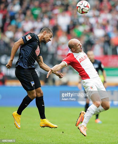 Marcel Ndjeng of Hertha fouls Tobias Werner of Augsburg during the Bundesliga match between FC Augsburg and Hertha BSC at SGL Arena on September 28...