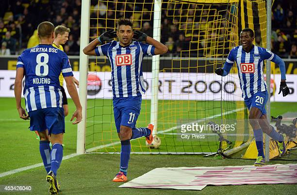 Marcel Ndjeng , Sami Allagui and Adrian Ramos celebrate a goal during the Bundesliga game between Borussia Dortmund and Hertha BSC on december 21,...