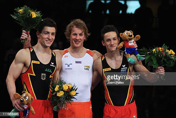 Marcel Nguyen of Germany for third place Epke Zonderland of Netherland for first place and Philipp Boy of Germany for second place pose on the podium...