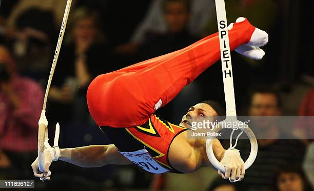Marcel Nguyen of Germany performs on the rings during the European Championships Artistic Gymnastics Men's All-Around Final at Max-Schmeling Hall on...