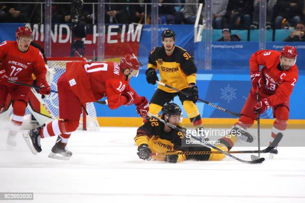 Marcel Noebels of Germany competes for the puck with Sergei Mozyakin and Pavel Datsyuk of Olympic Athlete from Russia in the first period during the...