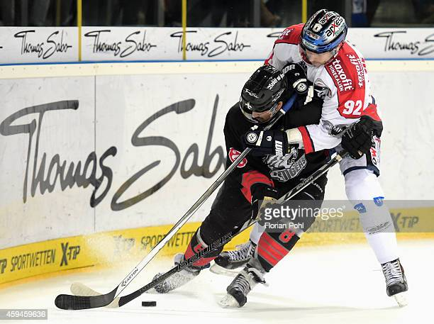 Marcel Noebels of the Eisbaeren Berlin duels with Marco Nowak of the Thomas Sabo Ice Tigers Nuernberg during the game between Thomas Sabo Ice Tigers...