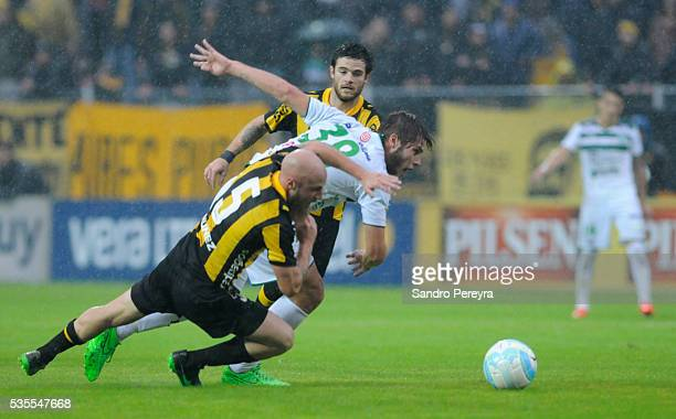 Marcel Novick of Penarol German Rivero of Plaza Colonia and Nahitan Nandez of Penarol fight for the ball during a match between Penarol and Plaza...