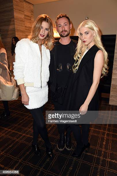 Marcel Ostertag Julia Trainer and a model pose at the Marcel Ostertag Charity Fashion Show at Sofitel Munich Bayerpost on November 13 2014 in Munich...