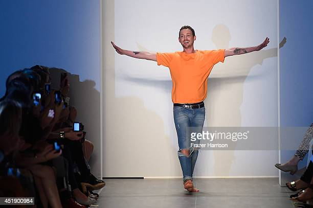Marcel Ostertag walks the runway at the Marcel Ostertag show during the MercedesBenz Fashion Week Spring/Summer 2015 at Erika Hess Eisstadion on July...
