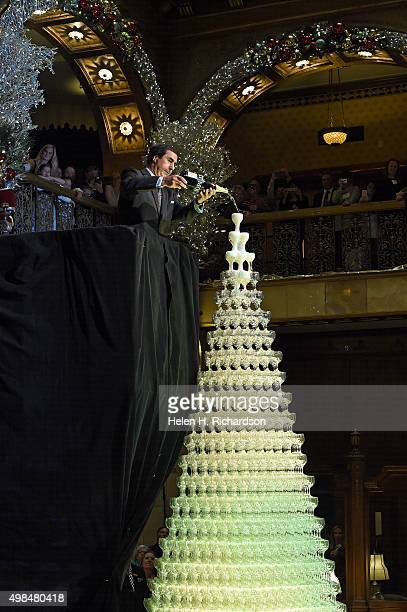 Marcel Pitton Managing Director for the Brown Palace gently pours a magnum of Moet Chandon champagne into glasses in the top tier of the champagne...