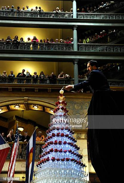 Marcel Pitton pours champagne into the top 150 glasses of the champagne cascade The Brown Palace Hotel and Spa held it's 21st Champagne cascade in...