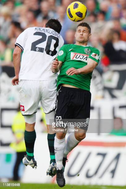 Marcel Podszus of Moenchengladbach and Patrick Huckle of Muenster head for the ball during the Regionalliga West match between Preussen Muenster and...