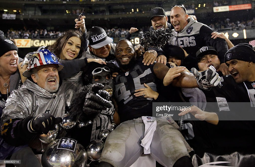 Marcel Reece #45 of the Oakland Raiders celebrates with fans in the Black Hole after the Raiders beat the Kansas City Chiefs at O.co Coliseum on November 20, 2014 in Oakland, California.