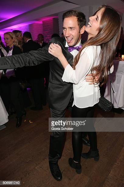 Marcel Remus and Lucia Strunz daughter of Claudia Effenberg dances during the Smoking Cocktail at Kaefer Atelier on January 26 2016 in Munich Germany