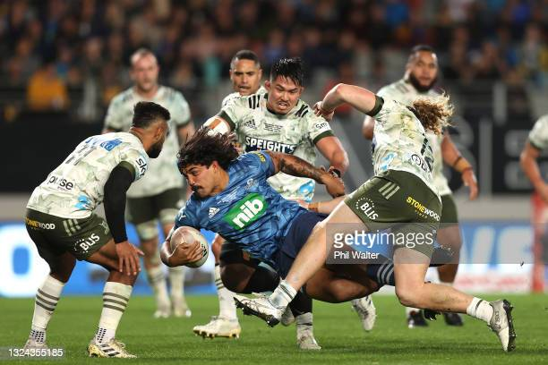 Marcel Renata of the Blues is tackled during the Super Rugby Trans-Tasman Final match between the Blues and the Highlanders at Eden Park on June 19,...