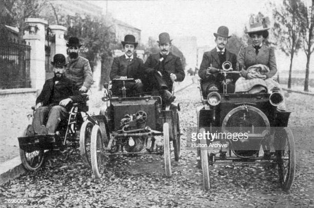 Marcel Renault on a 1898 quadricycle with his brother Louis at the wheel of the 1998 voiturette and Paul Huge at the wheel of the prototype 1899...