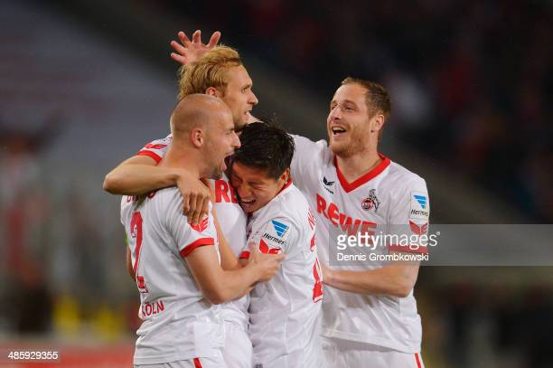 Marcel Risse of 1 FC Koeln celebrates with team mates afer scoring his team's first goal during the Second Bundesliga match between 1 FC Koeln and...