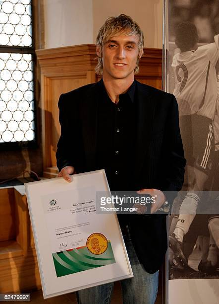 Marcel Risse of Bayer 04 Leverkusen poses with the bronze medal for the third best U19 player 2007/2008 during the Fritz Walter Medal Award 2008 at...