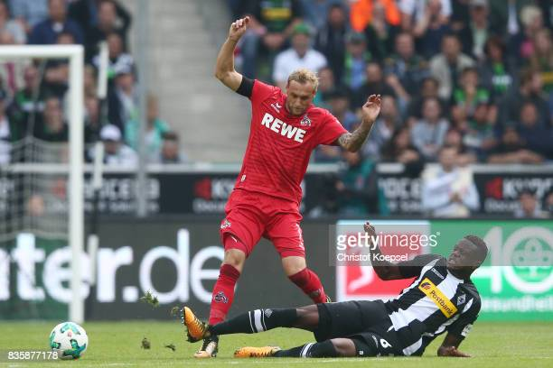 Marcel Risse of Koeln and Denis Zakaria of Moenchengladbach during the Bundesliga match between Borussia Moenchengladbach and 1 FC Koeln at...