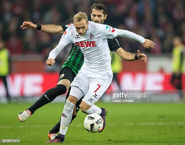 Marcel Risse of Koeln and Halil Altintop of Augsburg in action during the Bundesliga match between 1 FC Koeln and FC Augsburg at RheinEnergieStadion...