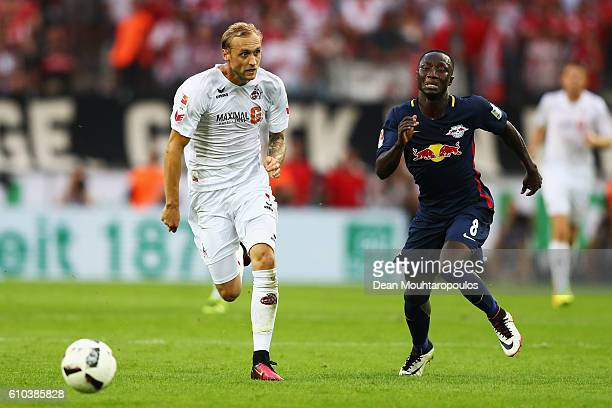 Marcel Risse of Koeln battles for the ball with Naby Keïta of RB Leipzig during the Bundesliga match between 1 FC Koeln and RB Leipzig at...