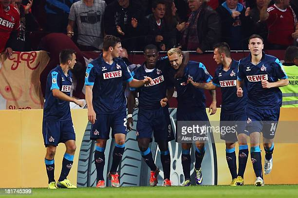 Marcel Risse of Koeln celebrates his team's first goal with team mates during the DFB Cup second round match between 1 FSV Mainz 05 and 1 FC Koeln at...