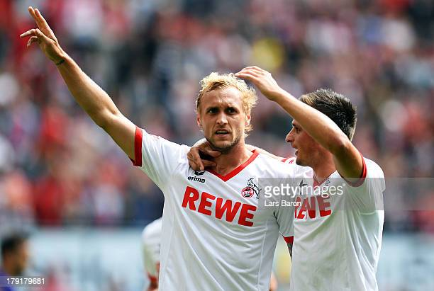 Marcel Risse of Koeln celebrates with team mate Slawomir Peszco after scoring his teams third goal during the Second Bundesliga match between 1 FC...