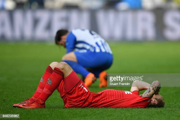 Marcel Risse of Koeln lies on the pitch dejected after the Bundesliga match between Hertha BSC and 1 FC Koeln at Olympiastadion on April 14 2018 in...