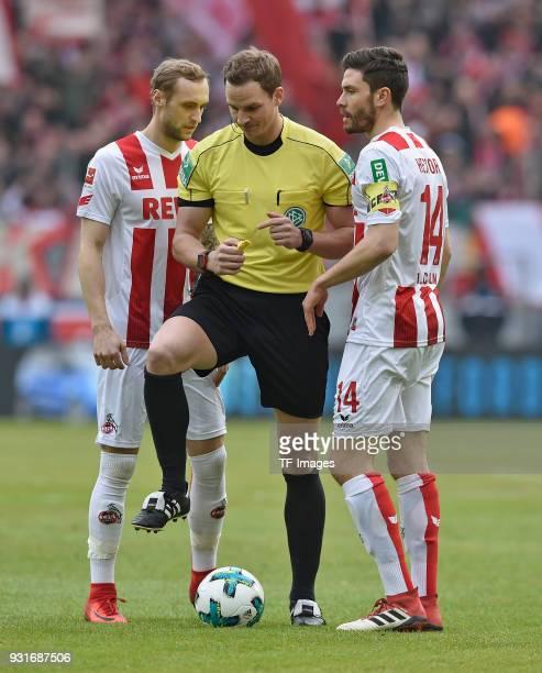 Marcel Risse of Koeln Referee Soeren Storks and Jonas Hector of Koeln look on during the Bundesliga match between 1 FC Koeln and VfB Stuttgart at...