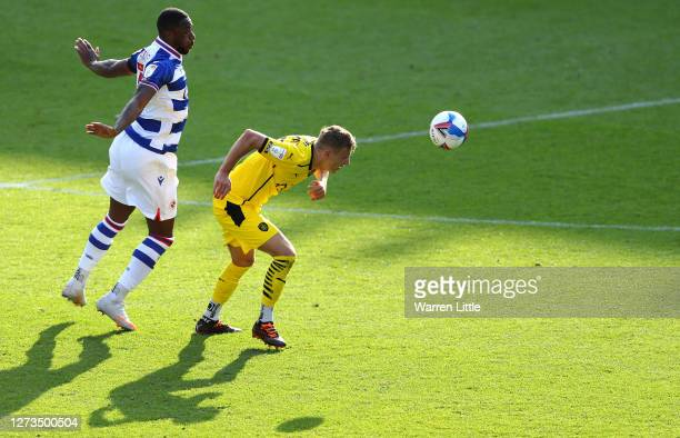 Marcel Ritzmaier of Barnsley is challanged by Yakou Meiute of Reading during the Sky Bet Championship match between Reading and Barnsley at Madejski...