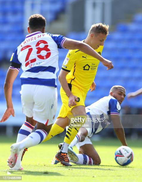 Marcel Ritzmaier of Barnsley is tackled by Andy Rinomhota of Reading during the Sky Bet Championship match between Reading and Barnsley at Madejski...