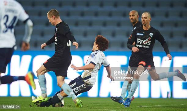 Marcel Romer of Sonderjyske and Mustafa Amini of AGF Aarhus compete for the ball during the Danish Alka Superliga match between AGF Aarhus and...