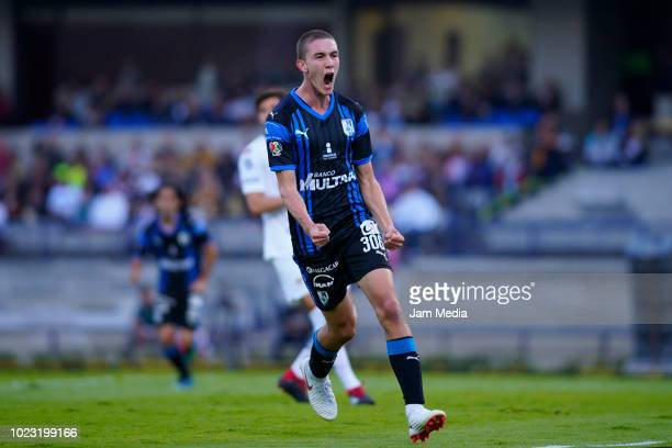 Marcel Ruiz of Queretaro celebrates after scoring the first goal of his team during the 6th round match between Pumas UNAM and Queretaro as part of...