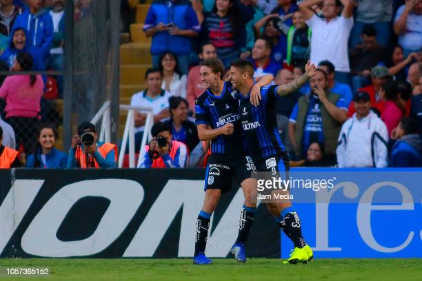 Marcel Ruiz of Queretaro celebrates with teammate Everaldo after scoring the second goal of his team during the 13th round match between Queretaro...