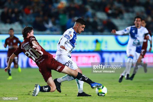 Marcel Ruiz of Queretaro struggles for the ball against Victor Guzman of Pachuca during the 2nd round match between Pachuca and Queretaro as part of...
