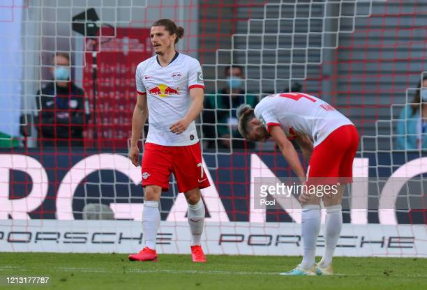 Marcel Sabitzer and Kevin Kampl of RB Leipzig react during the Bundesliga match between RB Leipzig and SportClub Freiburg at Red Bull Arena on May 16...