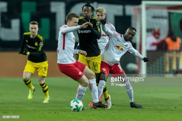 Marcel Sabitzer of Leipzig Ademola Lookman of Leipzig and Michy Batshuayi of Dortmund battle for the ball during the Bundesliga match between RB...