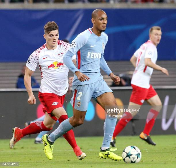 Marcel Sabitzer of Leipzig and Fabinho of Monaco battle for the ball during the UEFA Champions League group G match between RB Leipzig and AS Monaco...